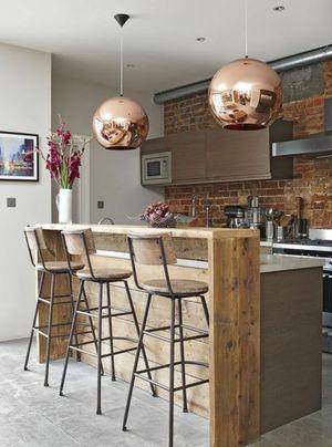 Кухня з барною стійкою: поради дизайнера щодо зонування й вибору меблів